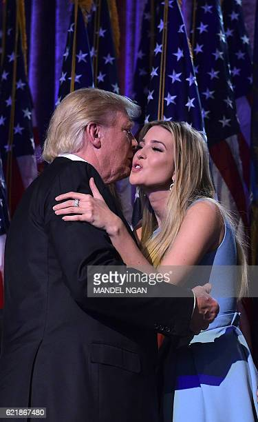 Republican presidential elect Donald Trump kisses his daughter Ivanka during election night at the New York Hilton Midtown in New York on November 9...