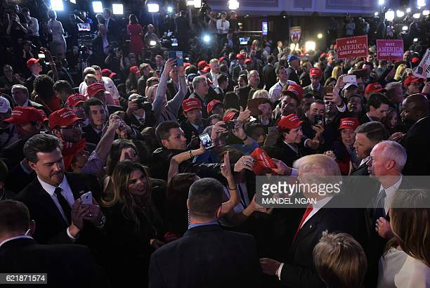 TOPSHOT Republican presidential elect Donald Trump meets supporters during election night at the New York Hilton Midtown in New York on November 9...