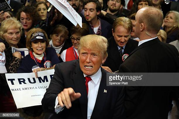 Republican presidential frontrunner Donald Trump pauses with supporters after speaking at the Mississippi Coast Coliseum on January 2 2016 in Biloxi...