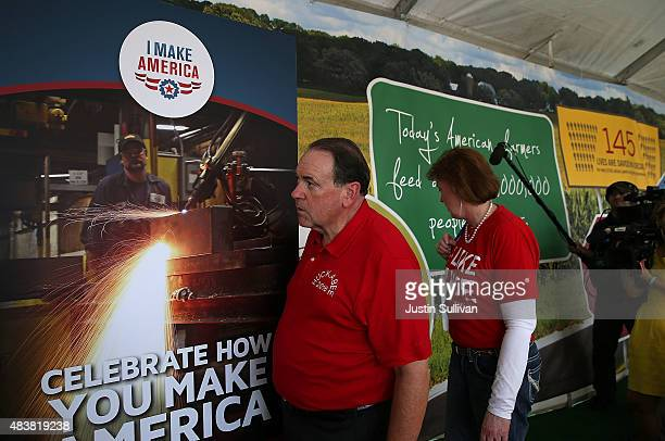 Republican presidential hopeful and former Arkansas Gov Mike Huckabee and his wife Janet tour the 'I Make America' booth at the Iowa State Fair on...
