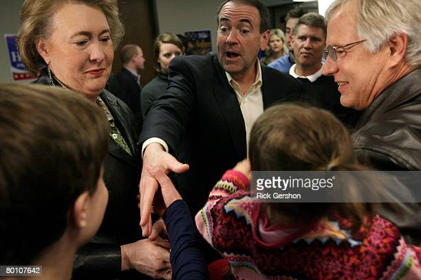 Republican presidential hopeful and former Arkansas Gov Mike Huckabee with his wife Janet greet volunteers at his campaign headquarters March 4 2008...
