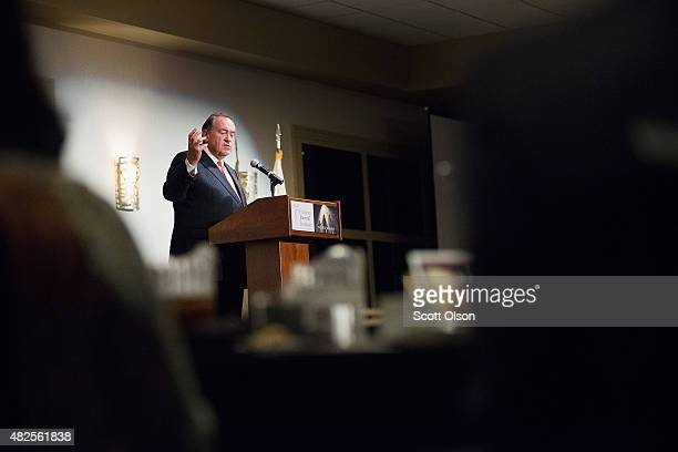 Republican presidential hopeful and former Arkansas Governor Mike Huckabee addresses guests gathered for the Freedom's Journal Institute for the...
