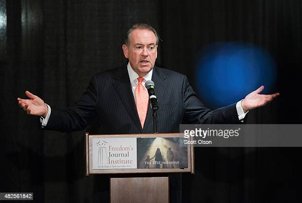 Republican presidential hopeful and former Arkansas Governor Mike Huckabee speaks to guests attending the Freedom's Journal Institute for the Study...