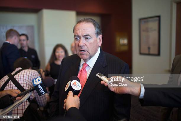 Republican presidential hopeful and former Arkansas Governor Mike Huckabee speaks to the press after addressing the Freedom's Journal Institute for...