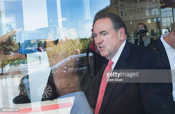 Republican presidential hopeful and former Arkansas Governor Mike Huckabee leaves after speaking to guests at the Freedom's Journal Institute for the...