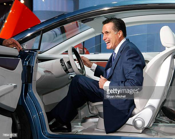 Republican presidential hopeful and former Massachusetts Gov Mitt Romney sits in the Chrysler EcoVoyager concept car as he tours the show floor at...