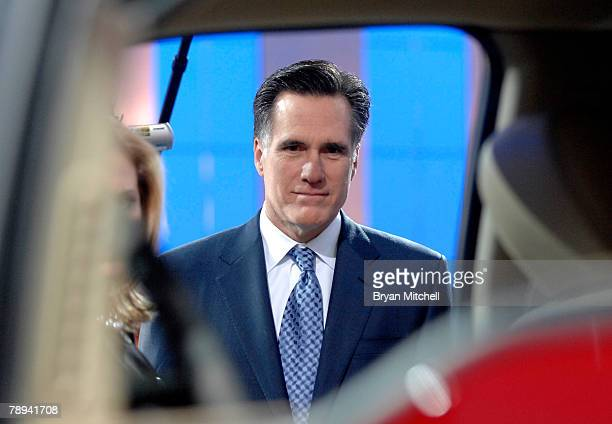 Republican presidential hopeful and former Massachusetts Gov Mitt Romney looks at the Ford F150 as he tours the show floor at the North American...