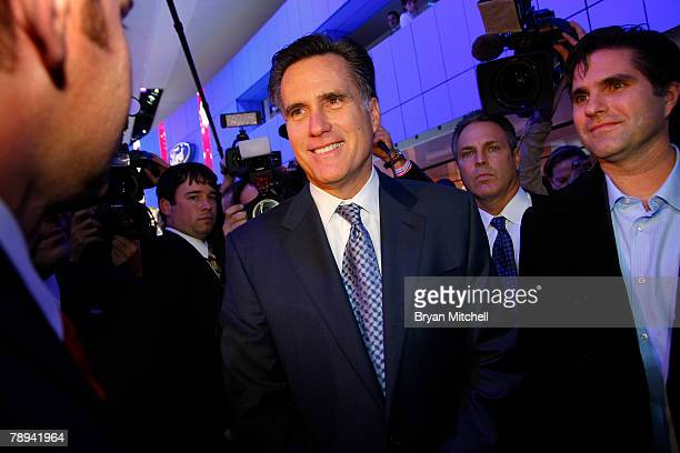 Republican presidential hopeful and former Massachusetts Gov Mitt Romney tours the show floor at the North American International Auto show at Cobo...