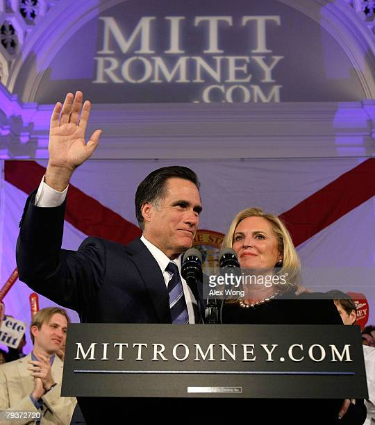 Republican presidential hopeful and former Massachusetts Gov Mitt Romney holds his wife Ann as he waves to supporters with his son Ben looking on...