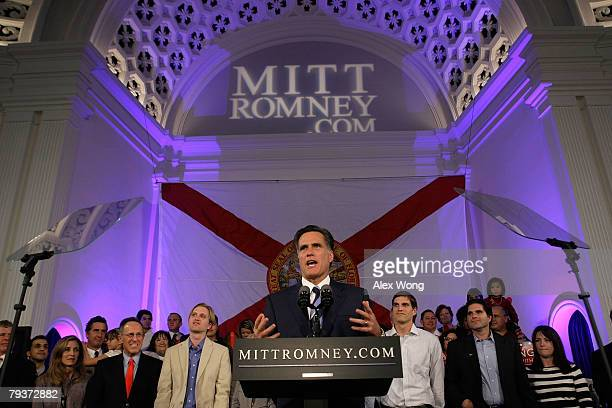 Republican presidential hopeful and former Massachusetts Gov Mitt Romney pauses as he speaks while his sons Ben and Josh look on during a post...