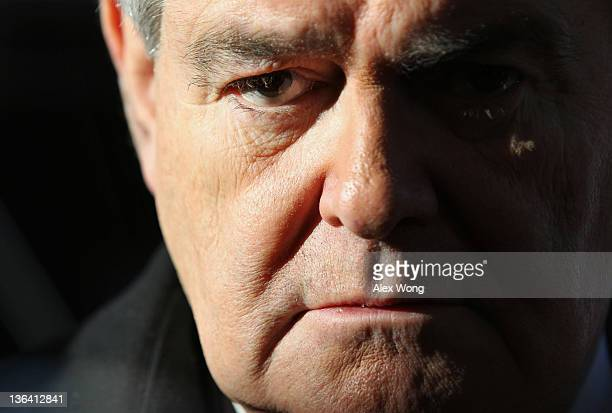 Republican presidential hopeful and former Speaker of the House Rep Newt Gingrich listens to questions from the media as he arrives at an education...