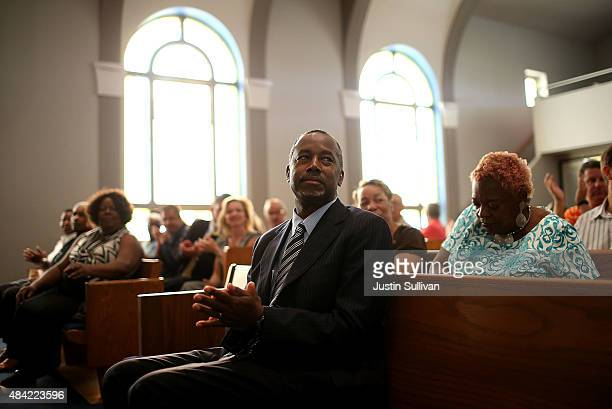 Republican presidential hopeful Ben Carson looks on during church services at Maple Street Missionary Baptist Church on August 16, 2015 in Des Moines...