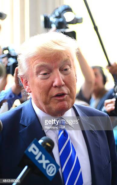 Republican Presidential hopeful Donald Trump arrives at Manhattan Supreme Court to report on August 17 2015 in New York City