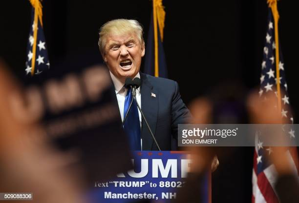 US Republican presidential hopeful Donald Trump speaks to the crowd during a rally February 8 2016 in Manchester NH US presidential candidates...