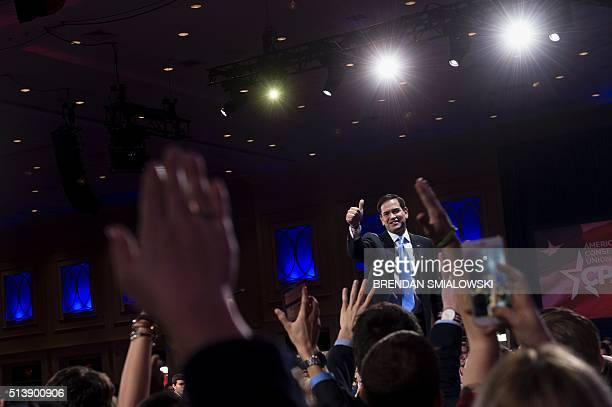 Republican Presidential hopeful Marco Rubio gives a thumbs up after speaking during the American Conservative Union Conservative Political Action...