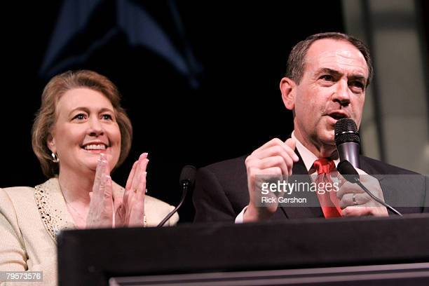 Republican presidential hopeful Mike Huckabee and his wife Janet take the stage to celebrate with supporters at a Super Tuesday watch party on...