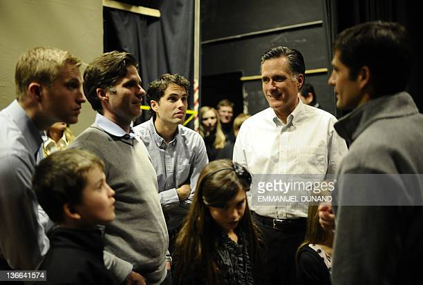 Republican presidential hopeful Mitt Romney share a moment with his children and grandchildren prior to get on stage to address a rally at McKelvie...