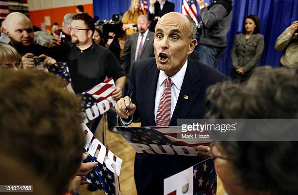 Republican presidential hopeful Rudy Giuliani reacts when a supporter tells him she was getting his autograph for her 93yearold mother following his...
