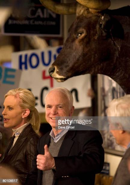 Republican presidential hopeful Sen John McCain acknowledges the crowd while wife Cindy looks on before a town hall meeting at Goode Company Barbeque...