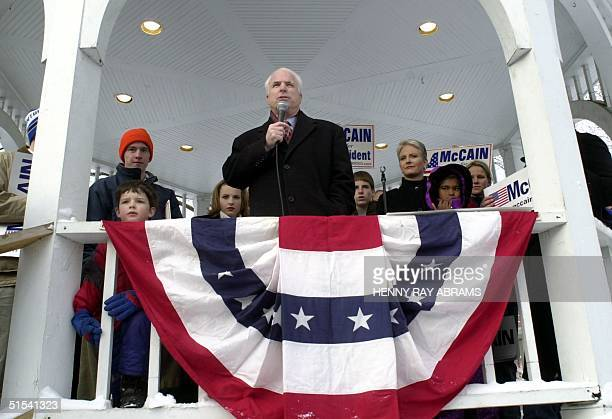 Republican presidential hopeful Sen John McCain is surrounded by family members while addressing a rally in the central square of Keene New Hampshire...