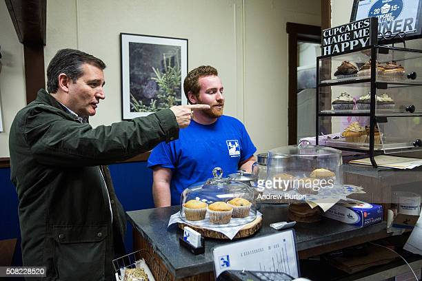 Republican presidential hopeful Sen Ted Cruz orders a caramel crunch cupcake at the Blue Moose cafe after holding a campaign event at The Village...