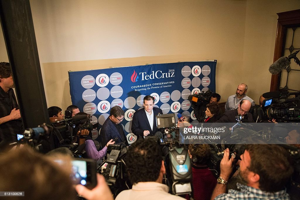 US Republican presidential hopeful Sen. Ted Cruz speaks to the media with Texas governor Greg Abbott and former governor Rick Perry following a presidential campaign rally in Dallas, Texas following a campaign rally in Dallas, Texas February 29, 2016, one day before the 'Super Tuesday' primaries. Americans in a dozen states head to the polls for a slew of primaries and caucuses March 1 on what is considered the most important day of the presidential nominations calendar. / AFP / Laura Buckman