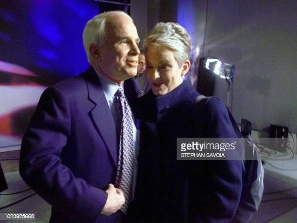 Republican presidential hopeful Senator John McCain gets a hug from his wife Cindy after the final debate before super Tuesday via satellite from...