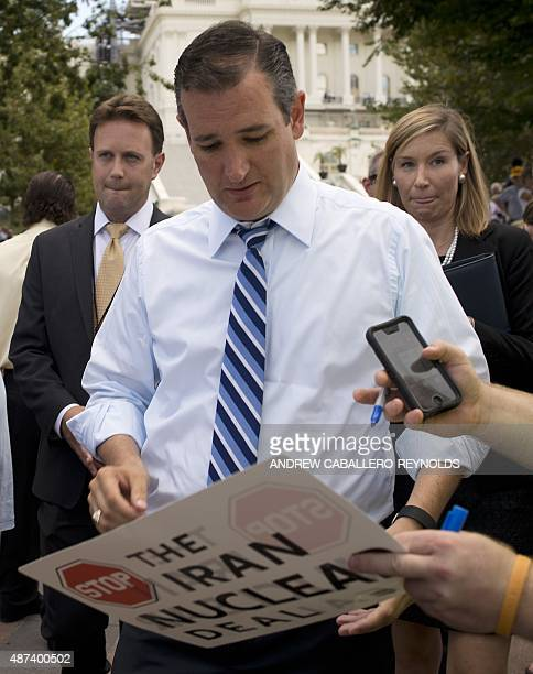 US Republican Presidential hopeful Senator Ted Cruz signs a placard before speaking at a Tea Party rally against the international nuclear agreement...