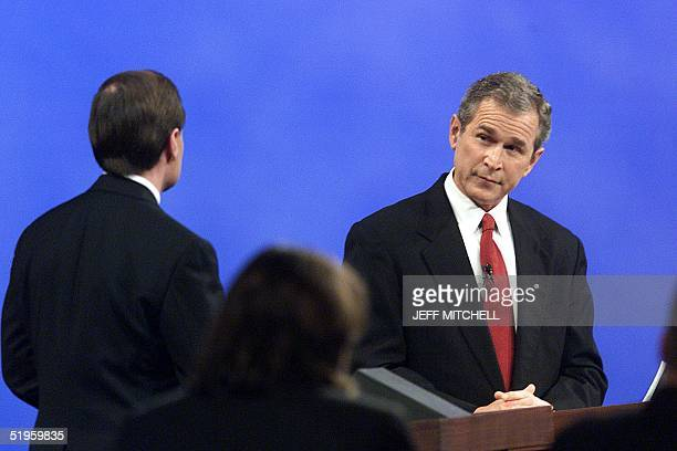 Republican presidentiaL hopeful Texas Gov. George W. Bush listens to a question from activist Gary Bauer at the Orpheum Theater in Phoenix, Arizona,...
