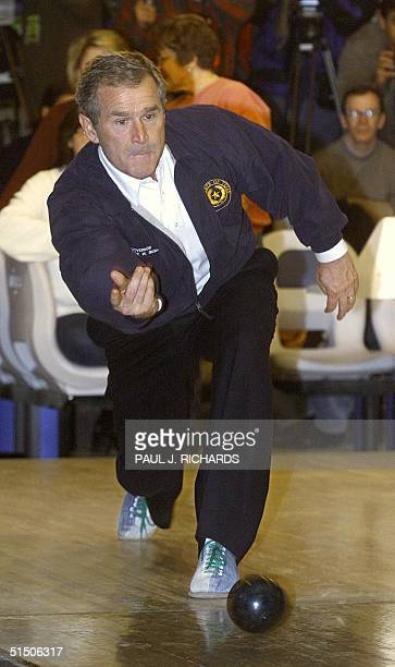 Republican presidential hopeful Texas Governor George W Bush plays candle pin bowling the night before the New Hampshire primary at Leda Bowling...