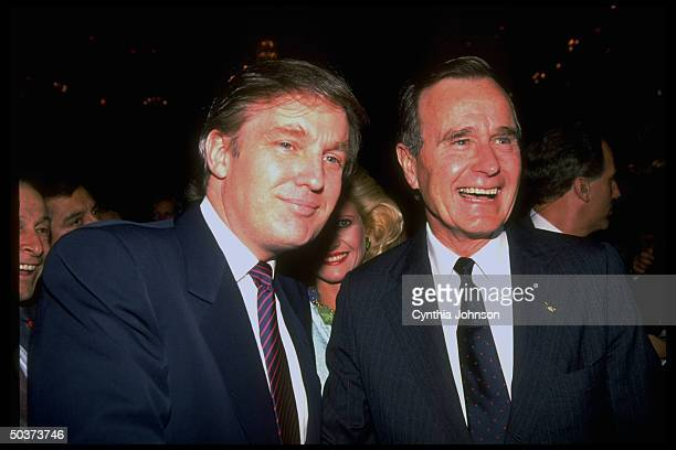 Republican presidential hopeful VP George Bush socializing w. Real estate mogul Donald & Ivana Trump during campaign event at Waldorf Astoria.