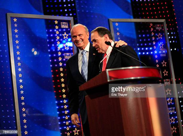 Republican presidential hopefuls former US Sen Fred Thompson and former Arkansas Gov Mike Huckabee talk after a televised debate at the Myrtle Beach...
