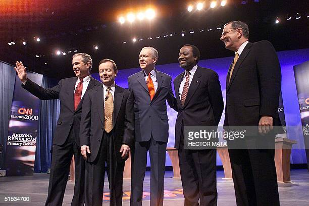 Republican presidential hopefuls Texas Gov. George W. Bush, activist Gary Bauer, Senator Orrin Hatch, Alan Keyes and Steve Forbes enter the stage of...