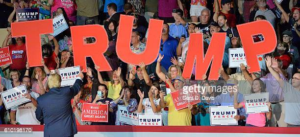 Republican presidential nominee Donald Trump acknowledges supporters' cheers during a campaign event at the Berglund Center on September 24 2016 in...