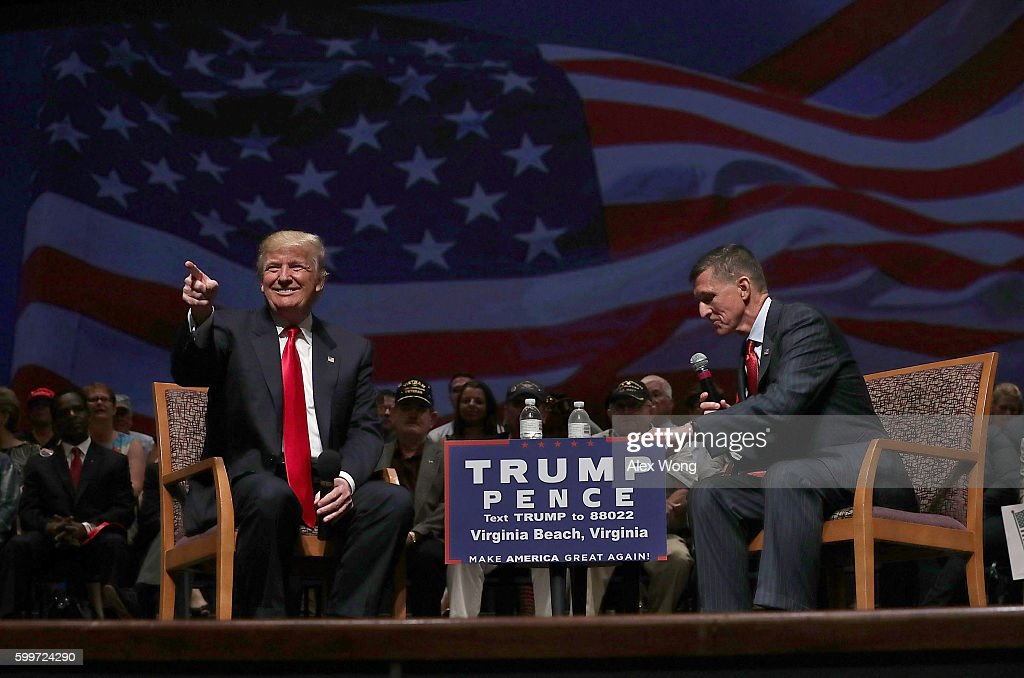 Republican presidential nominee Donald Trump (L) acknowledges the crowd during a campaign event September 6, 2016 in Virginia Beach, Virginia. Trump participated in a discussion with retired Army Lieutenant General Michael Flynn (R).