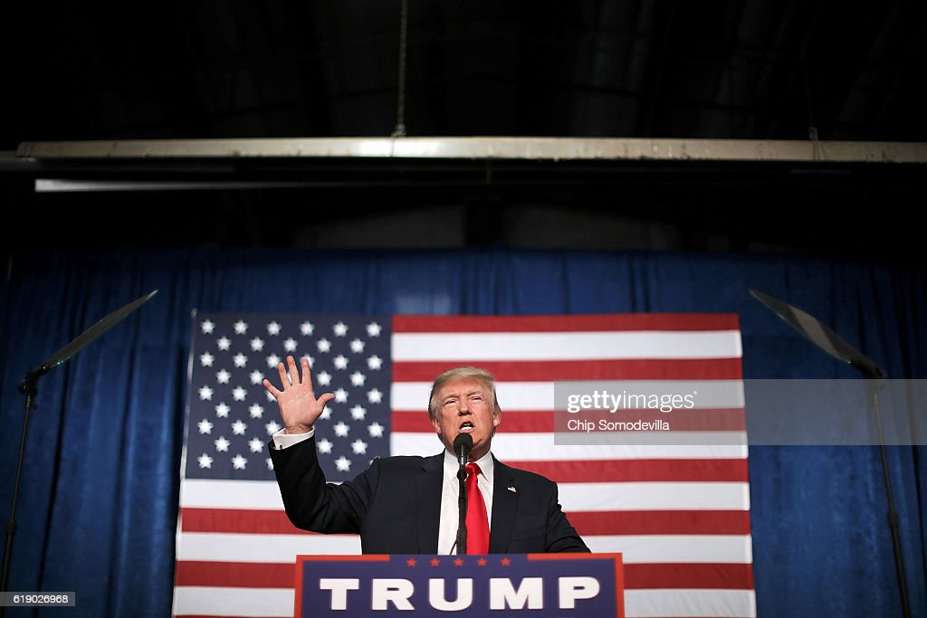 Republican presidential nominee Donald Trump addresses a campaign rally in the Rodeo Arena at the Jefferson County Fairgrounds October 29, 2016 in Golden, Colorado. The Federal Bureau of Investigation announced Friday it discovered emails pertinent to the closed investigation of Democratic presidential nominee Hillary Clinton's private email server and are looking to see if they improperly contained classified information. Trump said 'I think it's the biggest story since Watergate.'