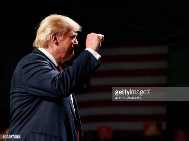 US Republican Presidential nominee Donald Trump addresses supporters at Macomb Community College on October 31 2016 in Warren Michigan Donald Trump...