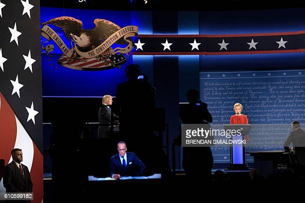 Republican presidential nominee Donald Trump and Democratic presidential nominee Hillary Clinton wait to begin the first US Presidential Debate at...