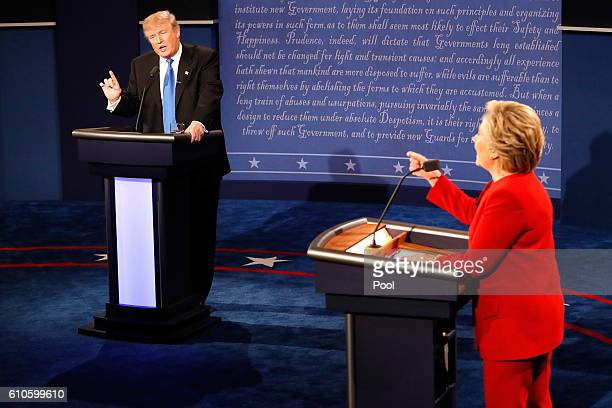 Republican presidential nominee Donald Trump and Democratic presidential nominee Hillary Clinton speak during the Presidential Debate at Hofstra...