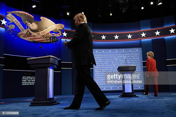 TOPSHOT Republican presidential nominee Donald Trump and Democratic presidential nominee Hillary Clinton walk to their lectures for the first US...