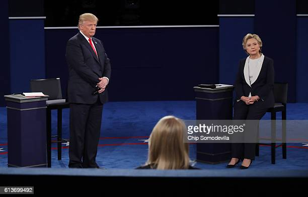 Republican presidential nominee Donald Trump and Democratic presidential nominee former Secretary of State Hillary Clinton appear on stage during the...