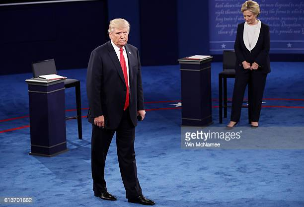 Republican presidential nominee Donald Trump and Democratic presidential nominee former Secretary of State Hillary Clinton appear during the town...