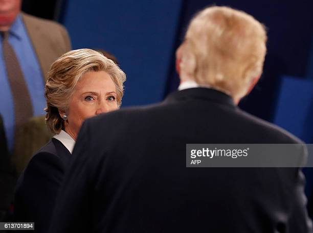 Republican Presidential nominee Donald Trump and Democratic nominee Hillary Clinton participate in a town hall debate at Washington University in St...