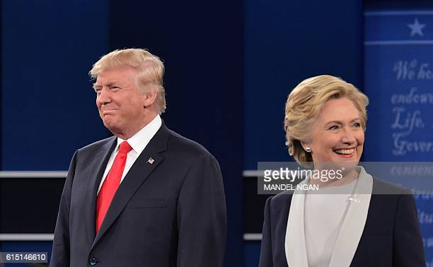 Republican presidential nominee Donald Trump and Democratic presidential nominee Hillary Clinton arrive on stage for the second presidential debate...