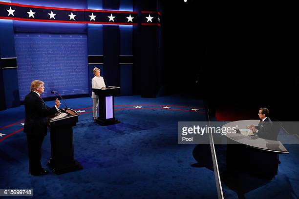 Republican presidential nominee Donald Trump and Democratic presidential nominee former Secretary of State Hillary Clinton listen to Fox News anchors...