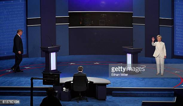 Republican presidential nominee Donald Trump and Democratic presidential nominee former Secretary of State Hillary Clinton walk onto the stage during...