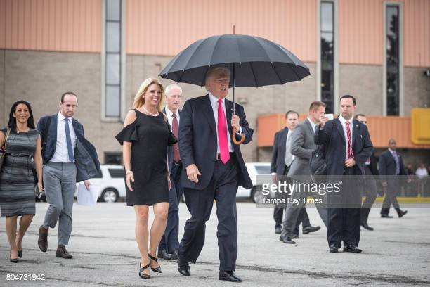 Republican presidential nominee Donald Trump and Florida Attorney General Pam Bondi walk to meet supporters organizing voter registration and Trump...