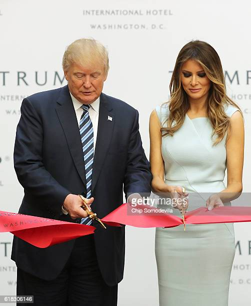 Republican presidential nominee Donald Trump and his wife Melania Trump cut the ribbon at the new Trump International Hotel October 26 2016 in...