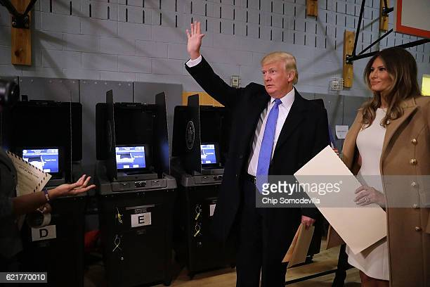 Republican presidential nominee Donald Trump and his wife Melania Trump casts their votes on Election Day at PS 59 November 8 2016 in New York City...