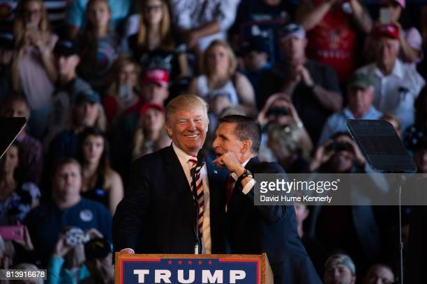 Republican Presidential Nominee Donald Trump and retired Lieutenant General Mike Flynn at a rally inside an aircraft hangar, Grand Junction,...